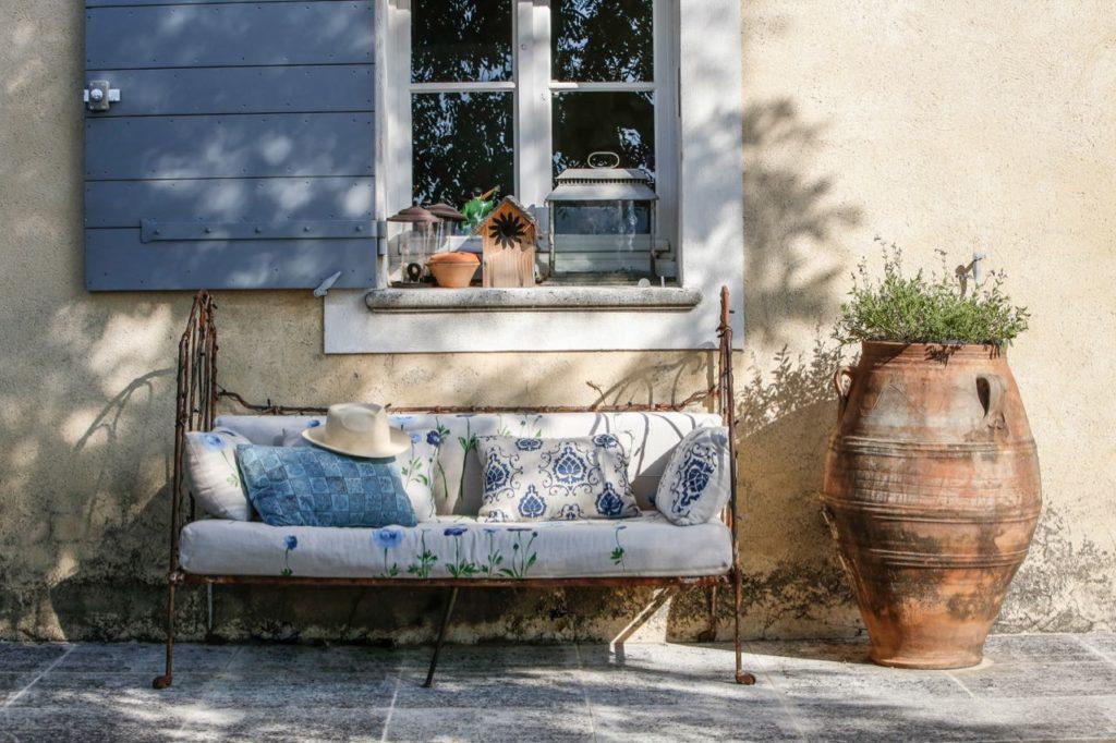 Outdoor sofa in patio at la Baye des Anges