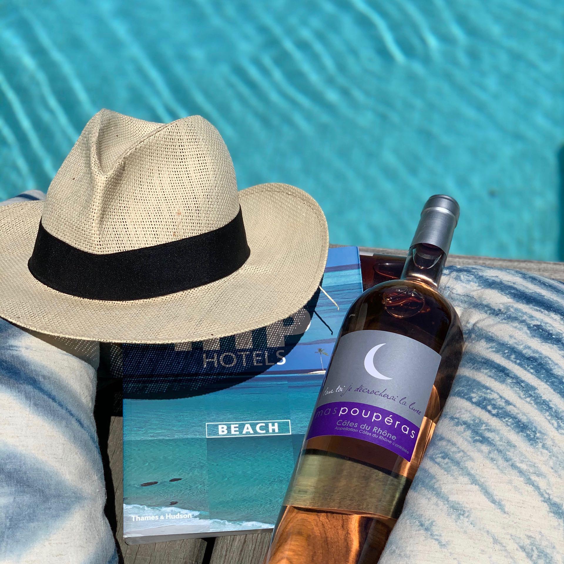 Pool hat book and wine rosé de Provence